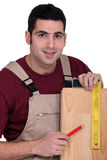 Tradesman using a try square Stock Images