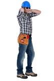 Tradesman wearing dark glasses Stock Image