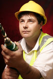 Tradesmen with a drill. Tradesmen with drill and large drill bit Stock Photo