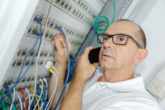 Tradesmen installing distribution board Royalty Free Stock Photography