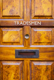 Tradesmen's entrance door Stock Photo