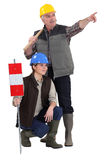 Tradespeople being distracted Royalty Free Stock Photo