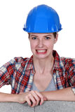 Tradeswoman baring her teeth Royalty Free Stock Photography
