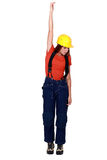 Tradeswoman being pulled up Royalty Free Stock Photography