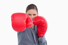 Tradeswoman with boxing gloves attacking Royalty Free Stock Photos