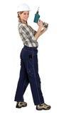 Tradeswoman con destornillador eléctrico Imágenes de archivo libres de regalías
