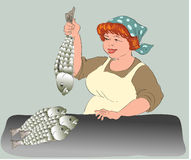 Tradeswoman by fish Royalty Free Stock Images