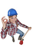 Tradeswoman giving the ok Royalty Free Stock Photos