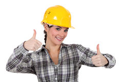 Tradeswoman giving two thumb's up Royalty Free Stock Photo