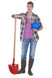 Tradeswoman with her shovel Royalty Free Stock Photography