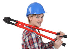 Tradeswoman holding boltcutters Royalty Free Stock Photos