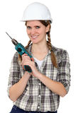 Tradeswoman holding a drill Stock Image