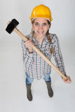 Tradeswoman holding a hammer Royalty Free Stock Photos