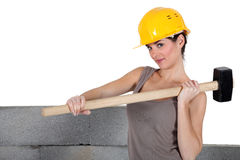 Tradeswoman holding a mallet Stock Image