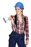 Tradeswoman holding a megaphone Royalty Free Stock Images
