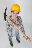 Tradeswoman holding a pickaxe Royalty Free Stock Photo
