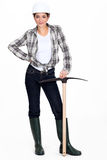 Tradeswoman holding a pickaxe Royalty Free Stock Images