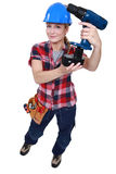 Tradeswoman holding a power tool Royalty Free Stock Photos