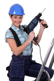 Tradeswoman holding a power tool Royalty Free Stock Photography