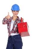 Tradeswoman holding a toolbox Stock Photo