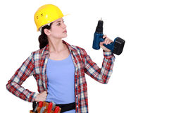 Tradeswoman holding an electric screwdriver royalty free stock photo