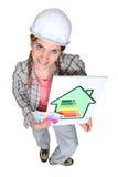 Tradeswoman holding wad of money stock photos