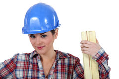 Tradeswoman holding wood Royalty Free Stock Images
