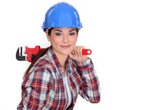 Tradeswoman holding a wrench Stock Photo