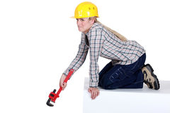 Tradeswoman holding a wrench Stock Images