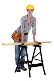 Tradeswoman leaning Stock Photography