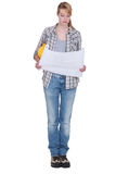 Tradeswoman looking at a blueprint Stock Photography
