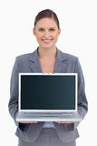 Tradeswoman presenting screen of her laptop Stock Images