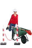 Tradeswoman pushing a wheelbarrow Royalty Free Stock Image
