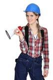 Tradeswoman retenant un mégaphone Images libres de droits
