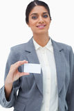 Tradeswoman showing blank business card Royalty Free Stock Photography