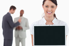Tradeswoman showing laptop with colleagues Royalty Free Stock Image