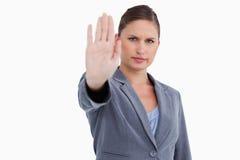 Tradeswoman signalizing stop Stock Images