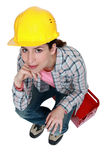 Tradeswoman sitting on toolbox Royalty Free Stock Image