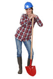 Tradeswoman with a spade Royalty Free Stock Photo