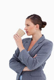 Tradeswoman taking a sip out of her paper cup Royalty Free Stock Photo