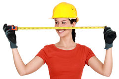 Tradeswoman using a measuring tape Stock Images