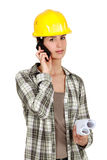 Tradeswoman using mobile phone Stock Image