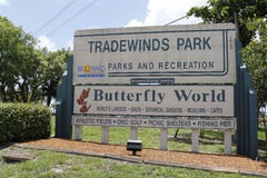 Tradewinds Park Butterfly World Sign. Coconut Creek, FL, USA - July 21, 2015: Large Tradewinds Park Butterfly World sign listing park attractions. Entrance sign Stock Image