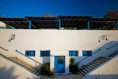 Tradicional vintage building in Greece. Blue sky and white walls. Colorful horizontal image Royalty Free Stock Photography