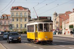 Tradidional yellow Tram in Belem street. Lisbon. Portugal. A yellow Tram in Belem street surrounded by old historical buildings in Alfonso de Albuquerque square Stock Photo