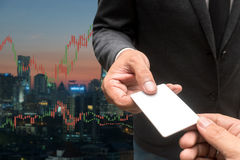 Trading Businessman hold blank credit card.and Forex Trading Lin. Es Graphs Stock Photo
