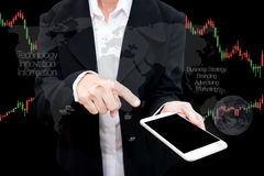 Trading Businessman hold smart phone.and Forex Trading Line Grap. Trading Businessman hold smart phone.and Forex Trading Lines Graphs Royalty Free Stock Photo