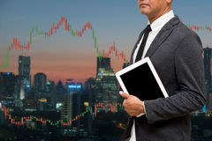 Trading Businessman hold smart phone.and Forex Trading Line Grap. Trading Businessman hold smart phone.and Forex Trading Lines Graphs Royalty Free Stock Photography