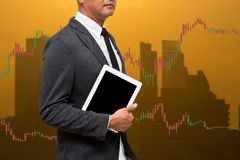 Trading Businessman hold smart phone.and Forex Trading Line Grap Royalty Free Stock Photo