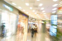 Trading center interior. Couple in a mall. Blurred motion image Stock Photography